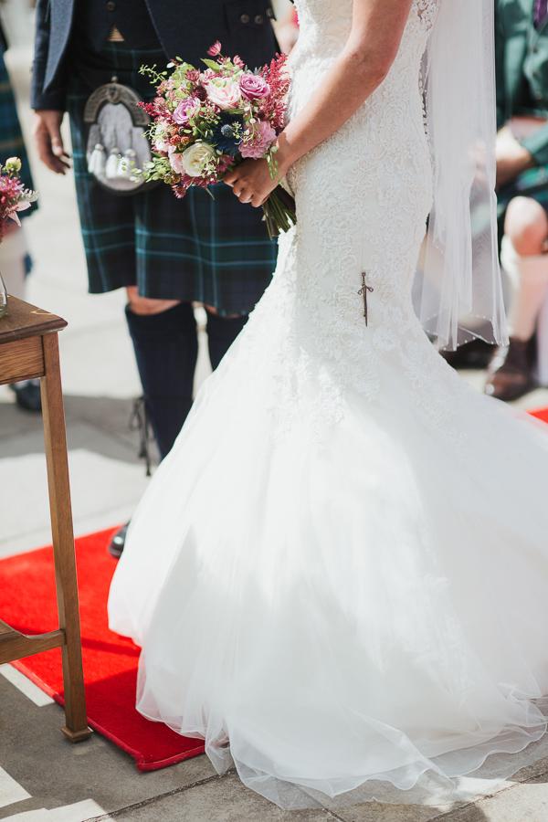 brides details during wedding ceremony