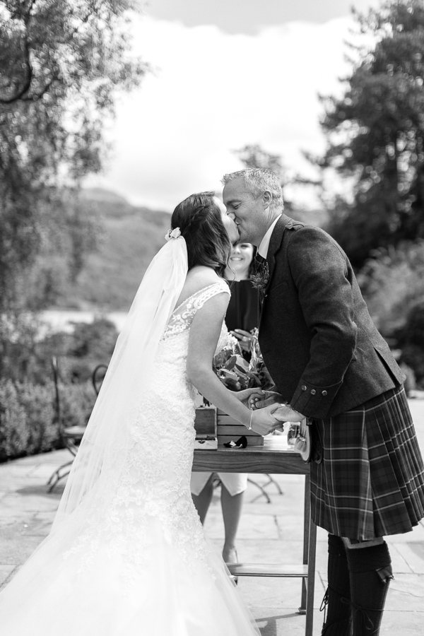 first kiss during ceremony at the lodge on loch goil