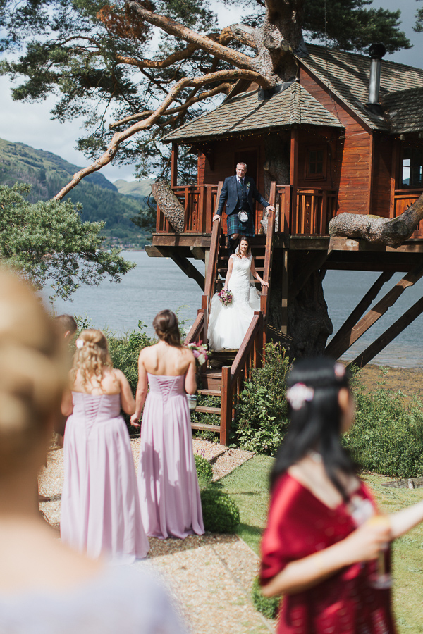 bride and groom at tree house over loch goil
