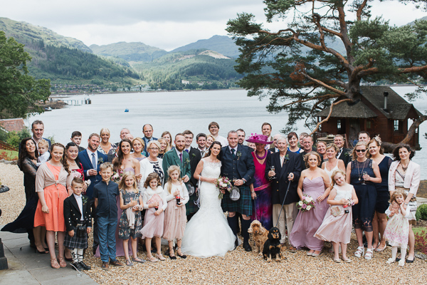 group shot of family and friends at the lodge on loch goil