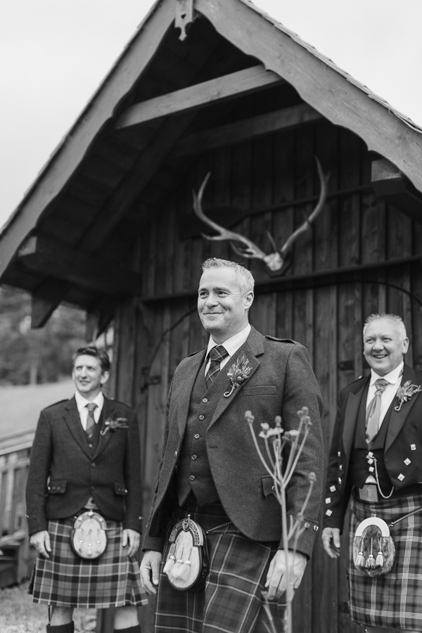groom with groomsmen at boat house loch goil