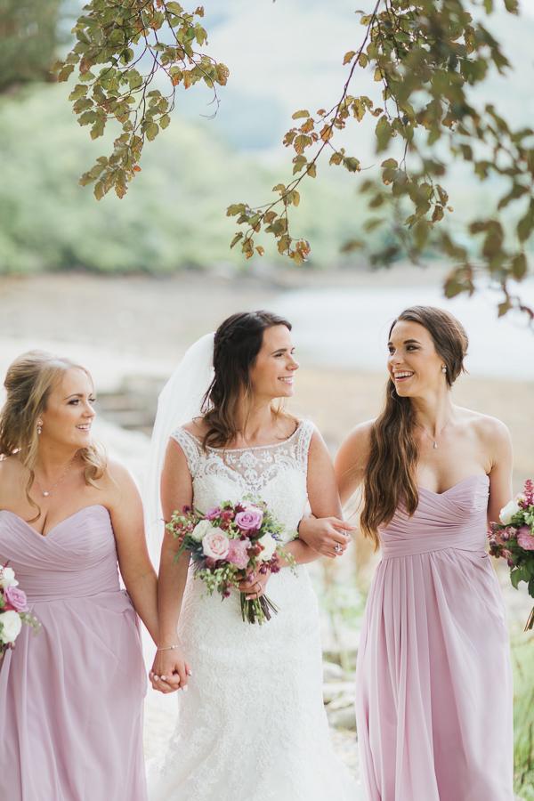 brides and bridesmates walking together