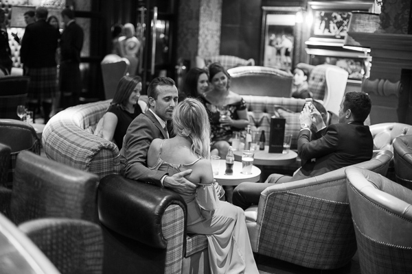guests relaxing at cameron house hotel bar