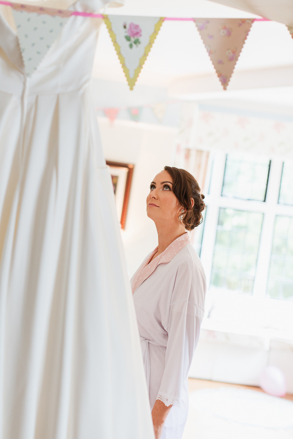 bride looking at her wedding dress bearsden glasgow