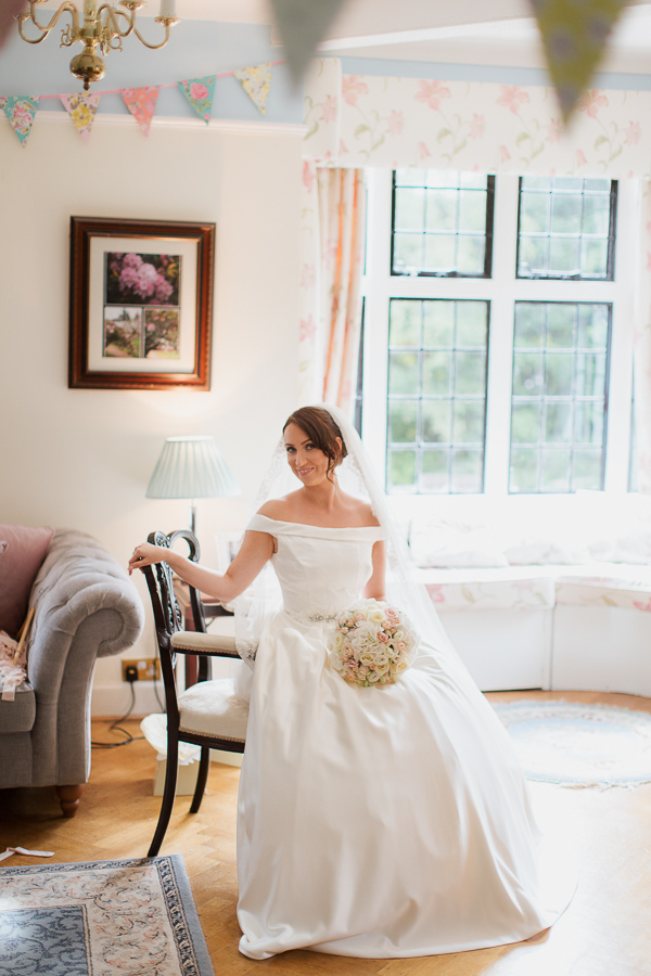 bride sitting on the her chair in the house bearsden glasgow