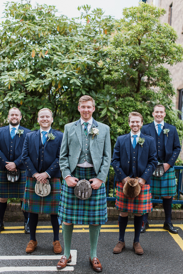 groom with ushers outside of the bearsden church glasgow