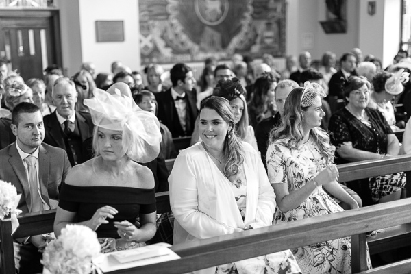 guests waiting for bride to arrive at the church in  bearsden scotland