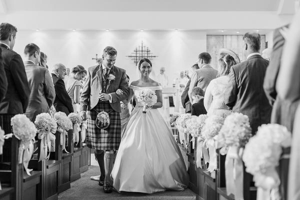 newlyweds walking down the aisle wedding photographer glasgow