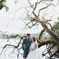 bride and groom next to fallen tree cameron house on loch lomond