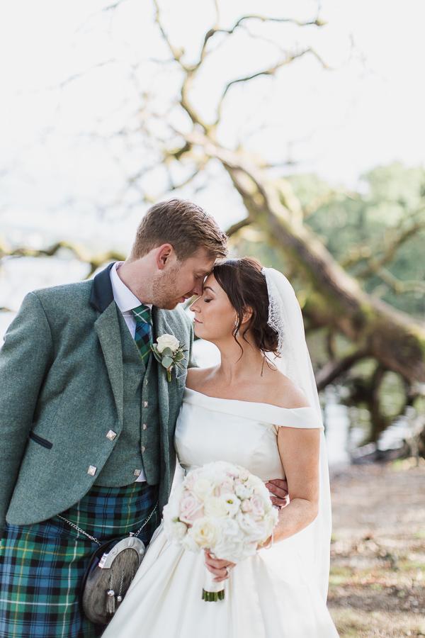 bride and groom clser together