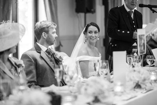 bride looking at groom during father