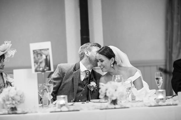 groom kissing bride just after jis speech fotogenic of scotland