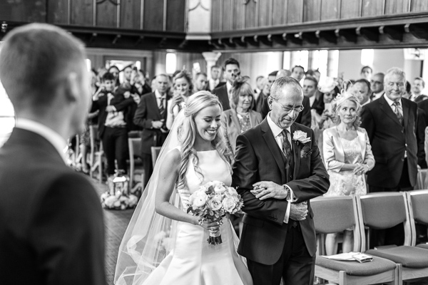 scottish bride arriving at the altar with her father scotland