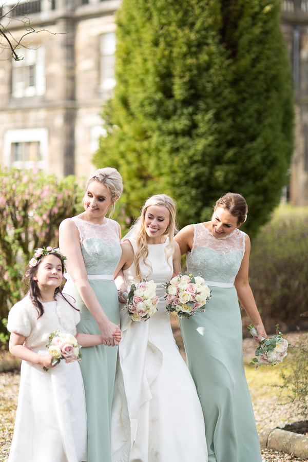bride with her bridal party outside of mar hall scotland