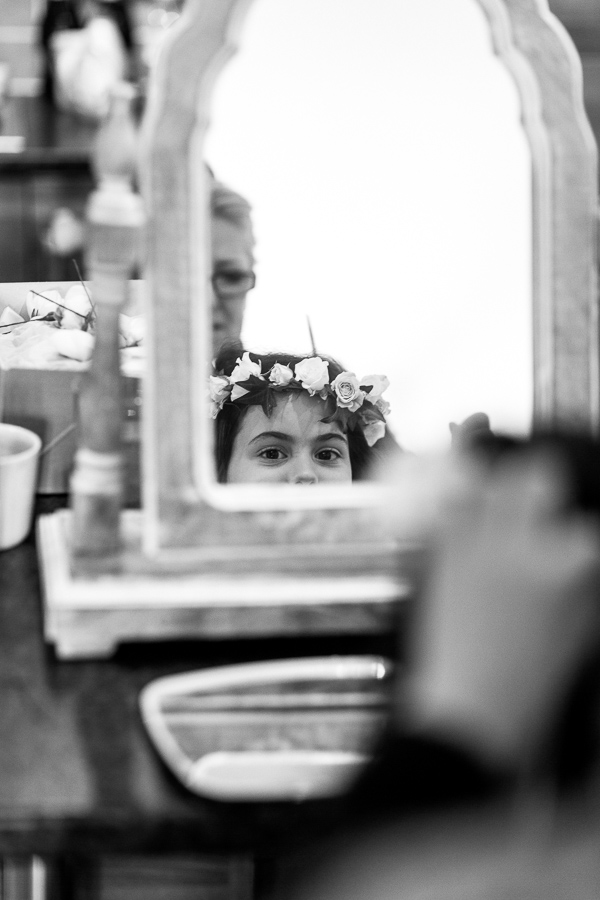 flower gril getting ready for a wedding in mar hall