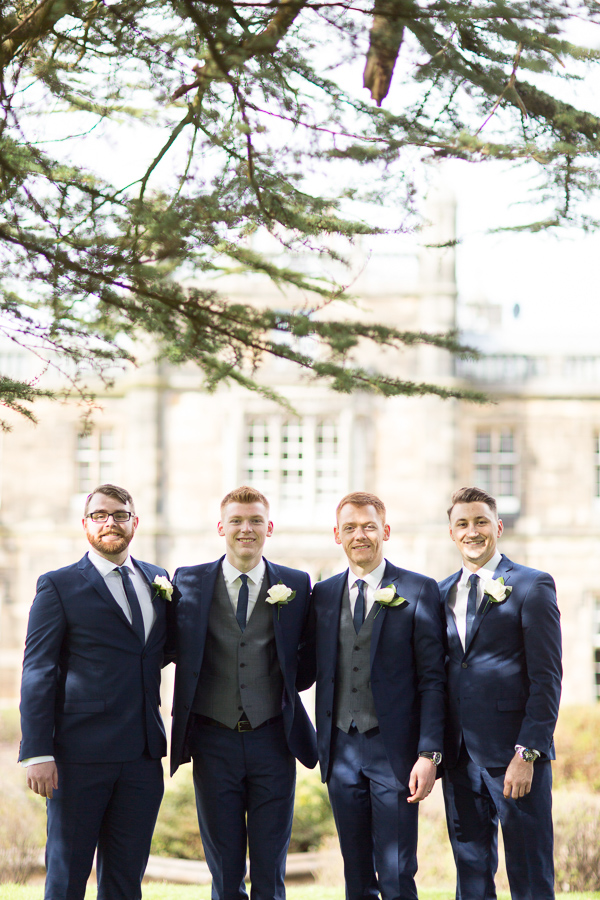 scottish groom with ushers in mar hall garden scotland