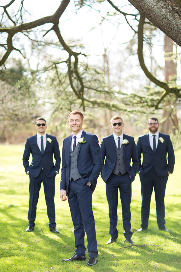 groom in focus of wedding photographer scotland
