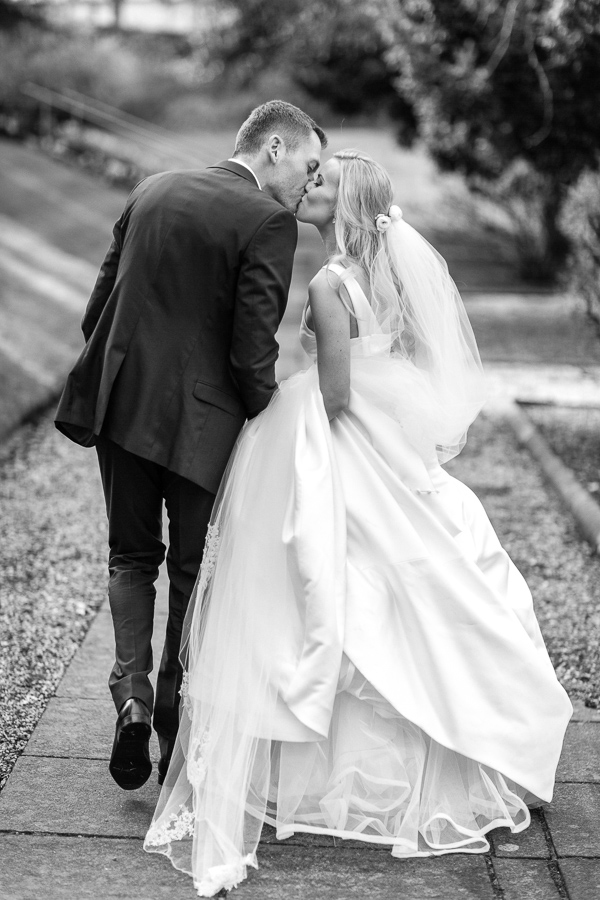 wedding couple kissing in the garden mar hall scotland