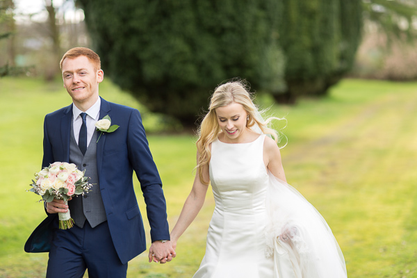 groom holding birdes hand at mar hall scotland