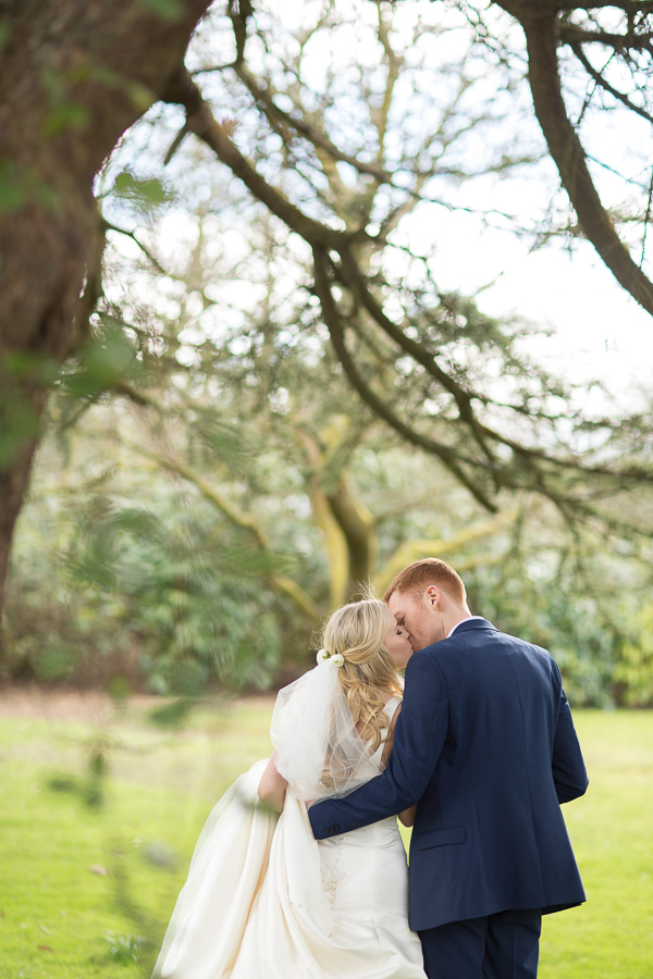 kissing under the tree at wedding venue mar hall scotland