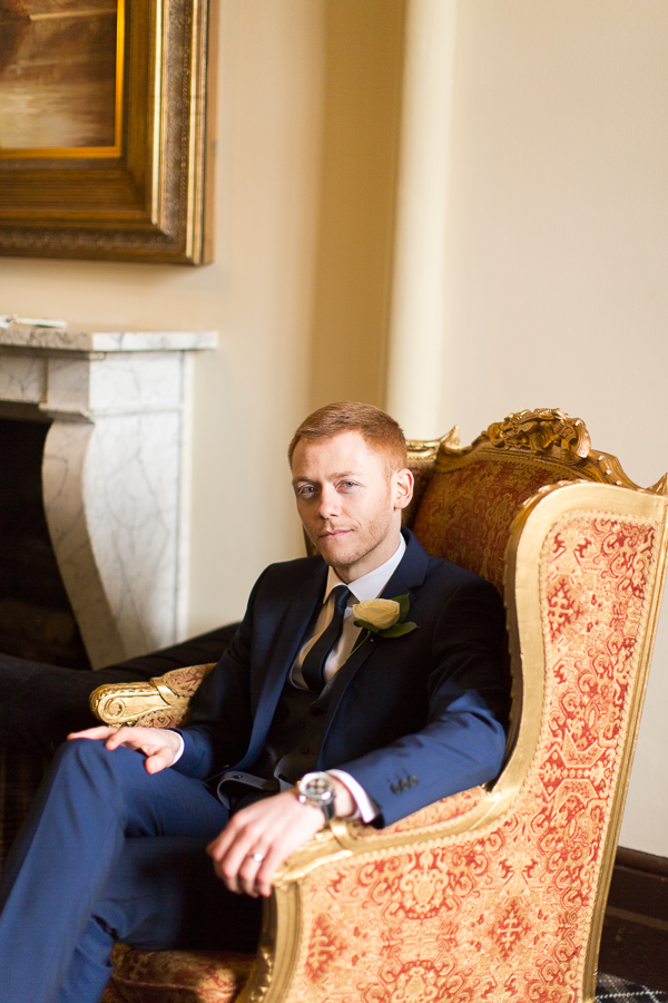 groom sitting in the armchair mar hall scotland