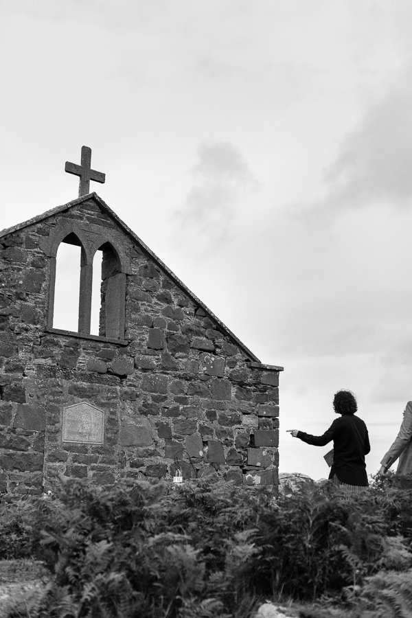 groom preparing for ceremony on a beach, church ruin in scotland