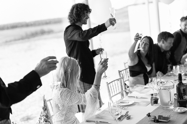 groom raising toast during wedding speeches at crear