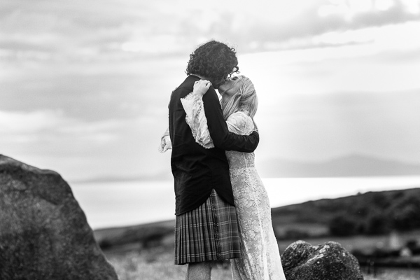 wedding photographer scotland groom and bride kissing on a hill