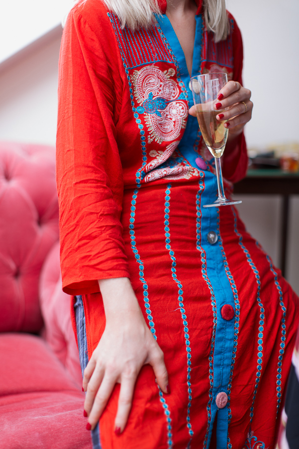 bride in oriental robe holding champaign glass at crear