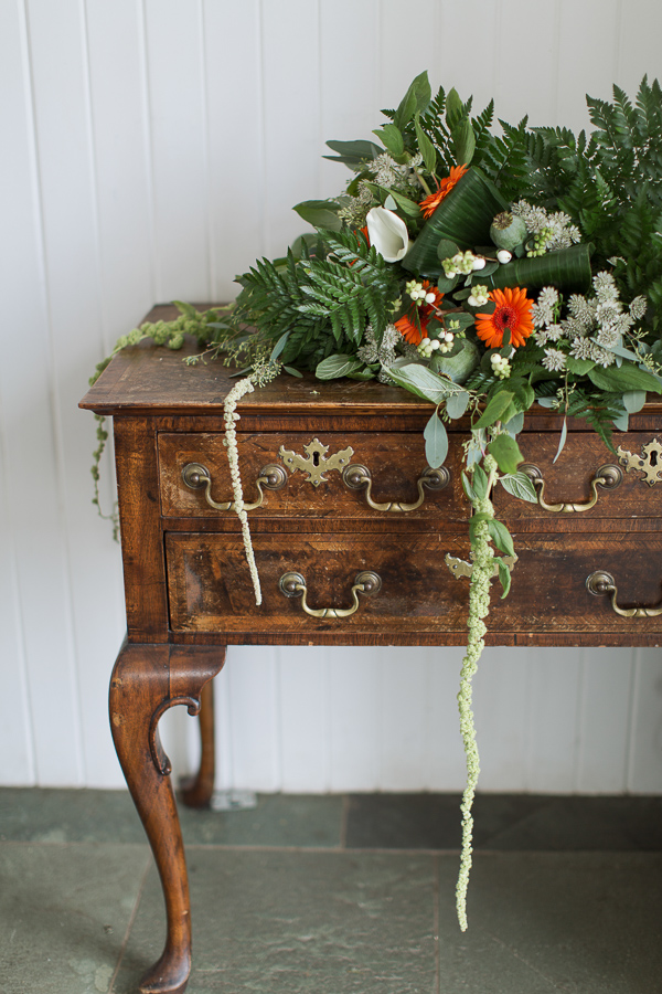 wedding flowers on a vintage chest at crear wedding venue