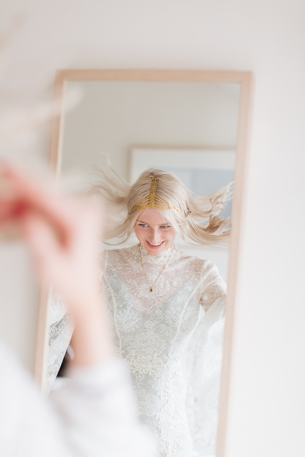 bride fixing her hair during preparations