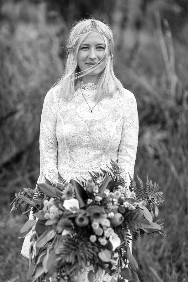 portrait of bride holding flowers and looking at the camera