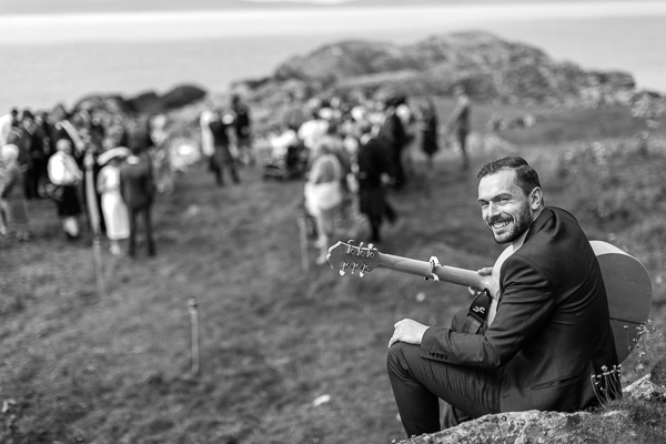 guitar player smiling playing at ceremony