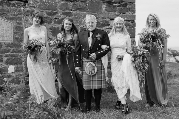 dad with bride and bridesmates just before ceremony