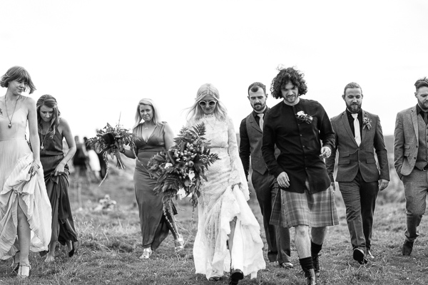 bride and groom with bridal party walking from wedding ceremony