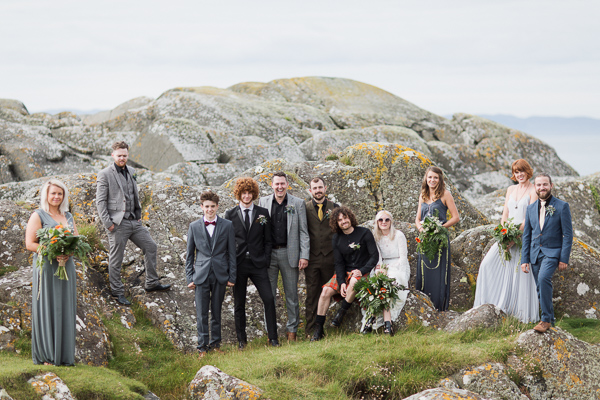 bridal party group shot with rocks wedding photos crear