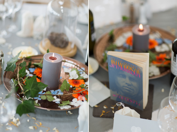 colourful wedding table decorations with candles and books