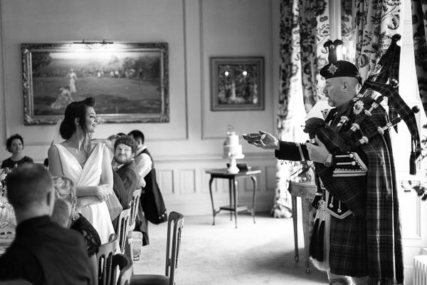 tradiotiona scottish piper whisky toast during wedding at dundas castle