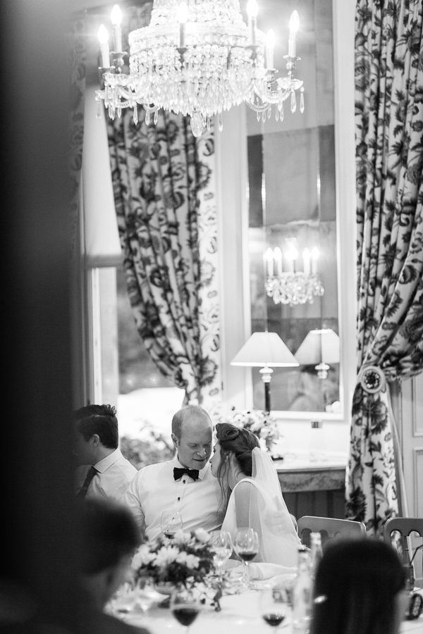bride and groom talking at wedding dinner table at dundas castle