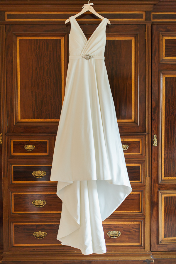 wedding dress hang on vintage wardrobe