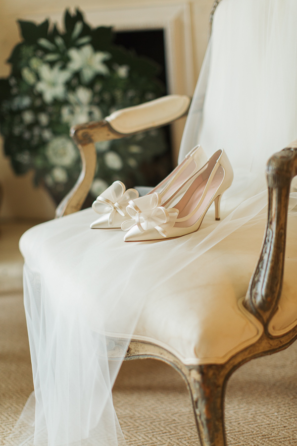 wedding shoes and veil on armchair