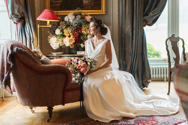 bride sitting in the main hall of dundas castle