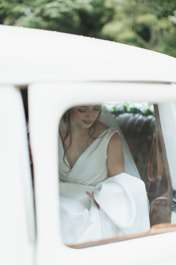 bride in a wedding car going out