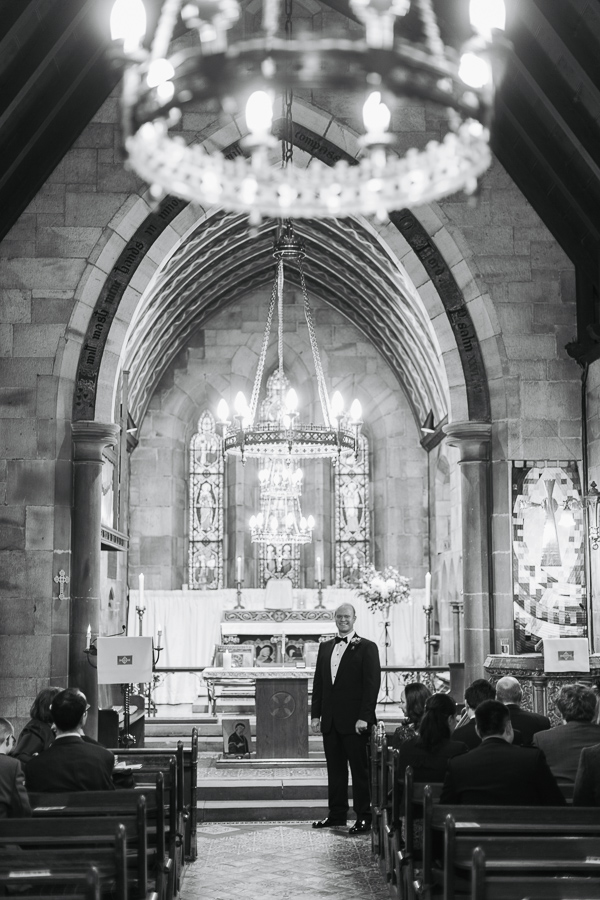 small country church in scotland wedding groom waiting at the altar