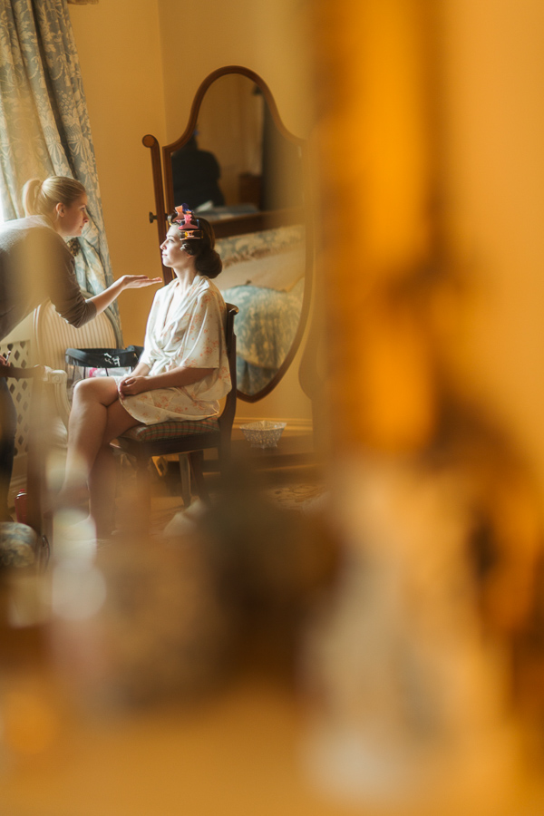 bride having her makeup done at dundas castle scottish wedding venue
