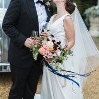 bride and groom kissing holding glasses dundas castle edinburgh