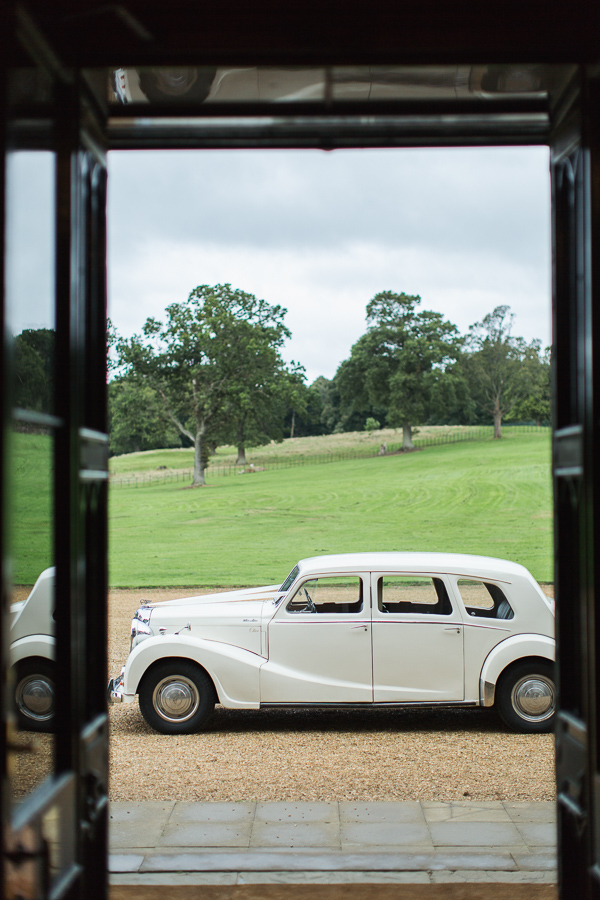 vintage wedding car parked in fron tof dundas castle scottish wedding venue