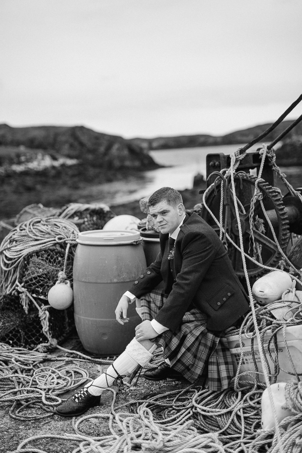 groom sitting on a harbour