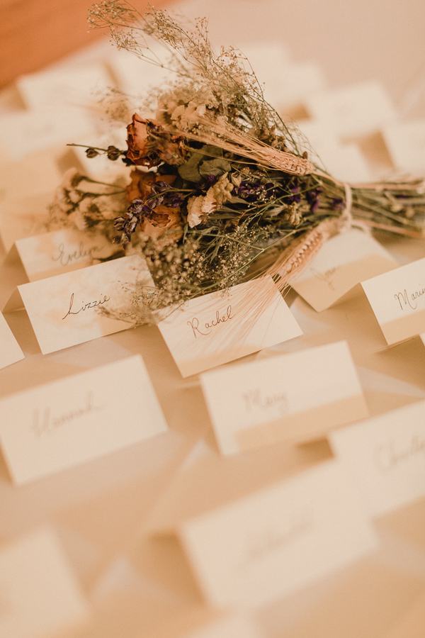 flowers between name tags