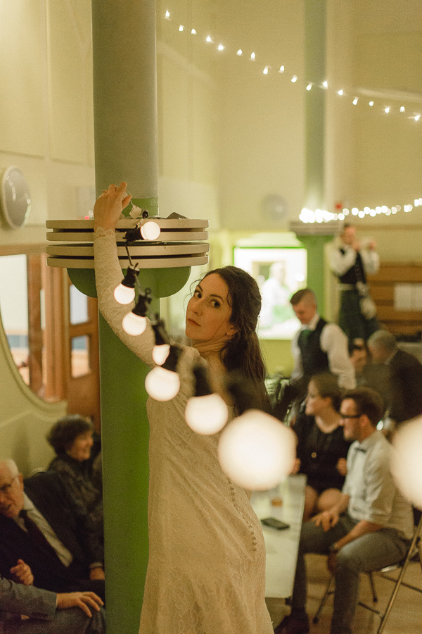 bride fixing lights at the venue